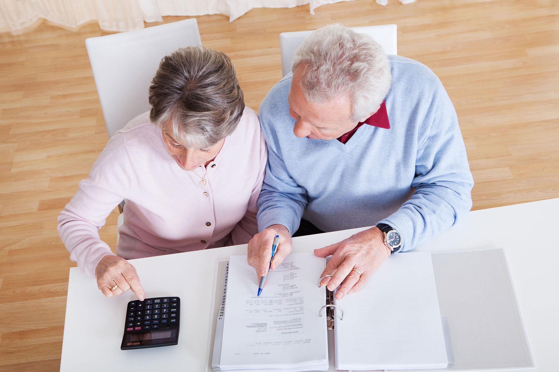 Senior couple looking over their estate plan
